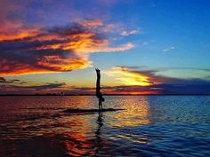 Handstand on a SUP at Sunset. Beautiful Yoga move on a Stand Up Paddle Board. Yoga SUP. Sunset Paddle. 2 Stand Up Guys Paddle Board Lessons & Sales 1701 Tamarack Ave Carlsbad, Ca 92008 (347)489-3926