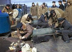 Fleet Air Arm personnel fusing bombs for Fairey Barracudas on the flight deck of HMS Victorious, before Operation 'Tungsten', the attack on the German battleship Tirpitz in Alten Fjord, Norway, April 1944 Victorious, Mustang, Midget Submarine, Royal Navy Aircraft Carriers, Naval Intelligence, Gun Turret, Abandoned Ships, Royal Marines, Ww2 Aircraft