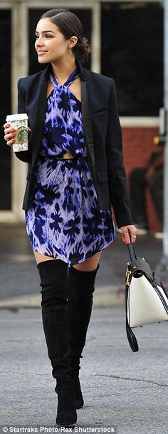 Beauty queen: The 23-year-old looked radiant, adding a simple black blazer and sexy heeled...