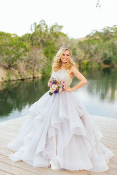 Featuring a crystal bodice and a flounced skirt with layers of frothy tulle in the dreamiest shade of purple (a kind of misty, angelic lavender), this Hayley Paige stunner makes its colorless counterparts seem positively dull. | Photo by Al Gawlik