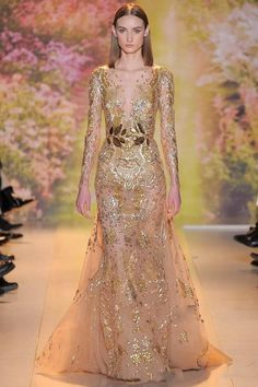 Luxury High Quality 2015 Sheer Gold Evening Gowns Applique Sequins V Neck Long Sleeves Sexy Dresses GL(China (Mainland))