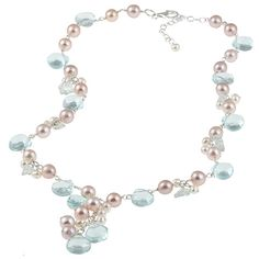 Give any fashionable girl a fun, versatile accessory with the Miadora freshwater pearl necklace that features accents of blue glass and blue topaz chips for extra fun. The gorgeous sterling-silver design is securely finished with a lobster-claw clasp.