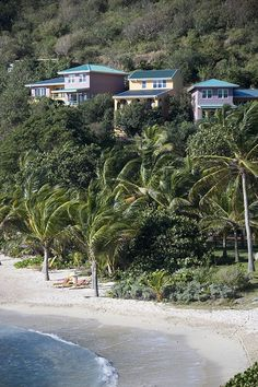 BVI beach at Frenchmans resort with villas nestling in the hills