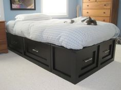 This lady built a bed with drawers underneath for her son. It's a knock-off of an expensive Pottery Barn design. It would be great for my room, 'cept I don't have enough floor space to open those drawers!