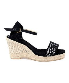 Get above it all with this pretty wedge! Crocheted canvas shapes the buckled upper, while the wrapped heel creates easygoing appeal.