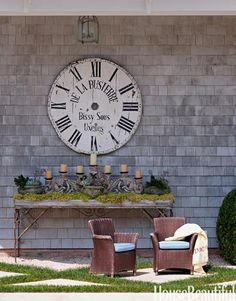 An oversize #French-clock face from #Devonshire hangs above a Provençal table near the pool.