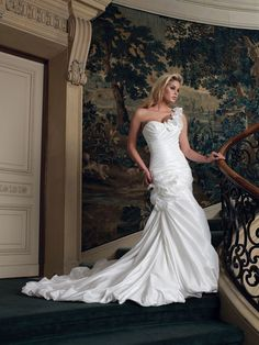 A preferred supplier of Everything But The Bride - Silk Wedding Gown with Flower Hip and Shoulder Detail