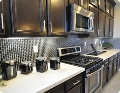 The brick pattern black subway tile on the backsplash run vertically instead of horizontally.