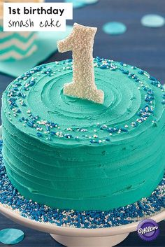 Your little one will love diving into this First Birthday Smash Cake! With a bold teal icing and a cute candy topper, this smash cake is sure to be a hit at the party! Boys 1st Birthday Cake, Happy First Birthday, Birthday Ideas, Tea Cakes, Cupcake Cakes, Cupcakes, Hazelnut Cake, Cakes For Boys, 1st Birthdays