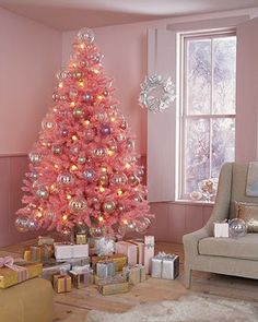 my Chirstmas style is kind of whimsical traditional and we put a tree in the kids rooms- this one makes me want to get Emmers a pink one