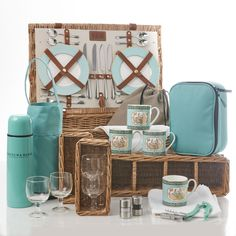 The St James's 4 Person Picnic Hamper ~ Who said that china can't be used while enjoying the outdoors? This hamper set by Fortnum & Mason has everything one needs for an outdoor feast, including bone china mugs and plates, cutlery, food containers and an insulated flask. Everything is neatly tied up in the signature F&M wicker basket.
