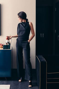 SHOP THE LOOK  A polished look for the office matched with a blazer, a large onyx  ring, and heeled sandals.   For the evening, an elegant jumpsuit that shows off the shoulder and back.  Pair it with subtle pieces like drop earrings, a strappy heel, and a black  clutch bag.    Photograph by Alice Gao