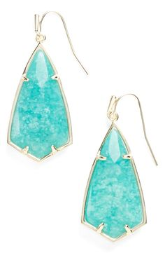Kendra Scott earrings in a bright pop of blue