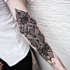 Tattoo for inner upper arm under lillies with colors blended through