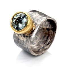 Disa Allsopp Jewellery | Oxidised silver wide band with 18kt gold set aquamarine $1,950.00