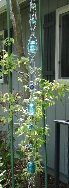 Rain chain made from vintage insulators and colored glass.