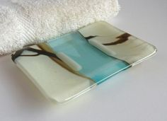 Elegant and contemporary style soap dish in french vanilla and brown streaky opaque glass, with a strip of transparent aqua glass in the center.