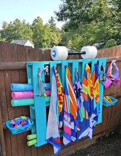 pool im garten ideen Get all your pool gear organized, and add a pop of color to your backyard with this Simple DIY Pallet Pool Storage!