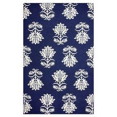"""Showcasing a floral motif in navy, this flatweave wool rug effortlessly anchors your dining table or living room seating group.  Product: RugConstruction Material: 100% WoolColor: NavyFeatures:  FlatweaveMade in India     Pile Height: 0.25""""Note: Please be aware that actual colors may vary from those shown on your screen. Accent rugs may also not show the entire pattern that the corresponding area rugs have.Cleaning and Care: Spot treat with a mild detergent and water. Professional cleaning…"""