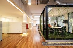 Image 12 of 38 from gallery of Autogasco Headquarters / Nicolás Maino Gaete. Photograph by Aryeh Kornfeld Corporate Office Design, Corporate Interiors, Office Interior Design, Office Interiors, Korn, House Columns, Office Dividers, 100 M2, Empire Romain