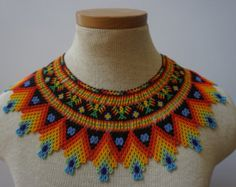 Embera beaded statement necklace by HouseofJwara on Etsy Beaded Statement Necklace, Tribal Necklace, Crochet Necklace, Beaded Necklaces, Seed Bead Patterns, Beading Patterns, Mexican Jewelry, Native Beadwork, American Indian Jewelry