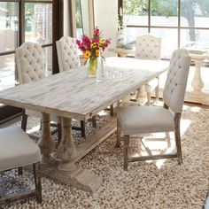 The transitional Windsor Dining Table is fabricated from reclaimed pine wood and…