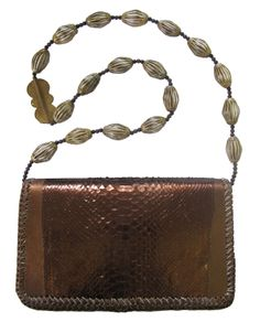 Python Box Clutch with Antique African Brass Bead Embellishment. We Deliver Worldwide. Order now by writing to us on Facebook or e-mailing mailto:sales@anna.... For further information about our products, studio and upcoming trunk shows please feel free to contact us.