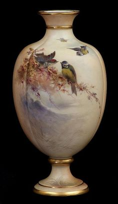 A Grainger & Co. Royal China Works Worcester gilt and blushed ivory ovoid pedestal vase, the panellebody painted with blue tits and other birds amidst branch work in landscape settings circa 1890-1900