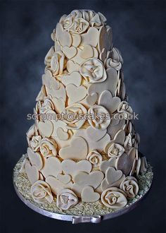 www.scrumptiouscakes.co.uk (827) - 4 tier white chocolate wrap wedding cake with white chocolate roses & hearts.
