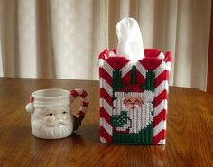 Santa is surrounded with candy canes in this cute tissue box cover.This brightly colored tissue box cover will be the perfect addition to your holiday