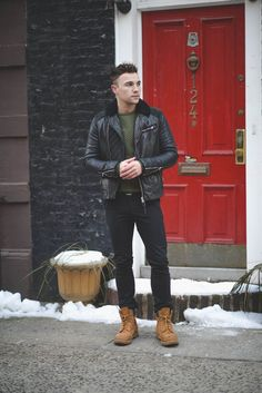 Shop this look on Lookastic:  https://lookastic.com/men/looks/black-bomber-jacket-dark-green-crew-neck-sweater-black-jeans-tan-boots/1545  — Dark Green Quilted Crew-neck Sweater  — Black Leather Bomber Jacket  — Black Jeans  — Tan Suede Boots