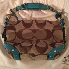 Coach hobo Tan and turquoise leather shoulder hobo. Large size, perfect condition used bag. Measures 14wide x9x6deep Bags Shoulder Bags