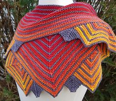 """This striking shawl evokes the step pyramids of Chichen Itza, which served as a temple to Kukulkan. Little is known about the original mythology of this """"feathered serpent"""" deity from Mesoamerica. In modern folklore, one story tells that Kukulkan flew to the sun to try and speak to it. The sun, too proud to speak to a plumed snake, burnt Kukulkan's tongue."""