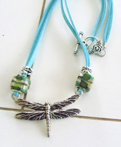 silver filled dragonfly and clasp w/ turquoise beads and suede