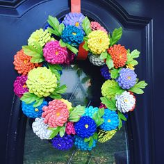 A personal favorite from my Etsy shop https://www.etsy.com/listing/274628566/zinnias-pinecone-wreath-zinnia-door