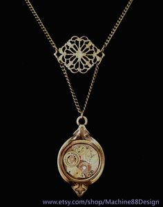 Victorian steampunk necklace and pendant with hand-placed vintage watch gears