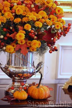 Pretty for the Thanksgiving table. Mum in a champagne bucket.