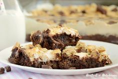 Easy One Bowl S'mores Brownies are loaded with chocolate and topped with marshmallows and graham cracker bits for a gooey, fudgy dessert you'll love!