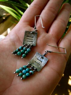 Jangly, dangly's for the lobes...In turquoise and hammered sterling.