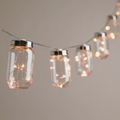 Our exclusive string lights feature 10 World Market favorite mason jars, each filled with five micro-LED lights that glow like fireflies. Battery-operated for maximum versatility, these affordable vintage-style string lights turn on and off automatically.