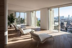 The penthouse apartment has six bedrooms, several sitting and dining areas, a kitchen, gym and study. Travertine stone columns are used as visual objects that help divide open sitting rooms into separated spaces.