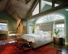 Gorgeous room.  Love the wall color, and the bed in front of the window.
