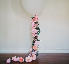 Decorate your bridal or baby shower with this adorable floral balloon from Green Wedding Shoes.  Follow this simple DIY and find everything you need at Afloral.com.