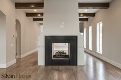 unique, modern fireplace that allows viewing on two sides, in both the dining room and the living room  (photo by Vladimir Ambia Photography)
