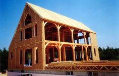 Timber frame with SIPs, photo courtesy of www.murus.com