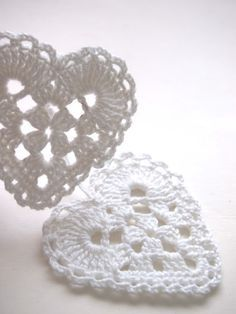 crochet heart idea - looks like 2 rounds of a basic granny square with an crochet loop added in the middle of two sides in round two.  Third round is crochet lots of double-crochets into each of the two loops and single crochet the rest of the way around.  Then a final loopy border to finish for the 4th round.