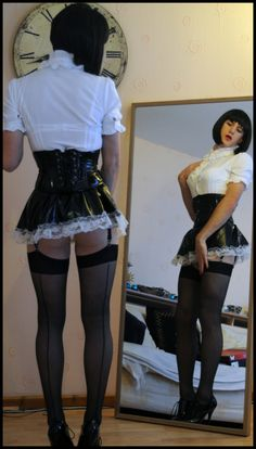 He steps in front of the full length mirror and Carla the Shemale is back.  She's wearing a severe black satin dress to which a small white apron is pinned. With a tight black maid's collar around her neck and black leather cuffs on her wrists, she is the very picture of a submissive. But her dress is proudly lifted up by a fine bosom and a large bulge in her skirt betrays her excitement.  (From: Carl to Carla, the story of a transformation)