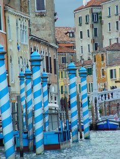 Striped moore poles in Venice.