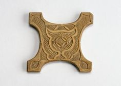 Thread winder, wood carved with abstract designs, used in weaving: Japan, Hokkaido, Ainu, 19th to early 20th century