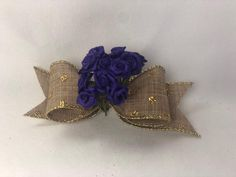She scrunches a dovetailed burlap ribbon long) in the Mini Bowdabra and adds another burlap ribbon making loops. She tops it with a bunch of decorative purple flowers over it and shapes the flowers and ribbons to complete the pretty little hair bow. Wedding Crafts, Diy Wedding Decorations, Wedding Ideas, How To Make Ribbon, Ribbon Making, Autumn Crafts, Diy Hair Bows, Burlap Ribbon, Fall Diy
